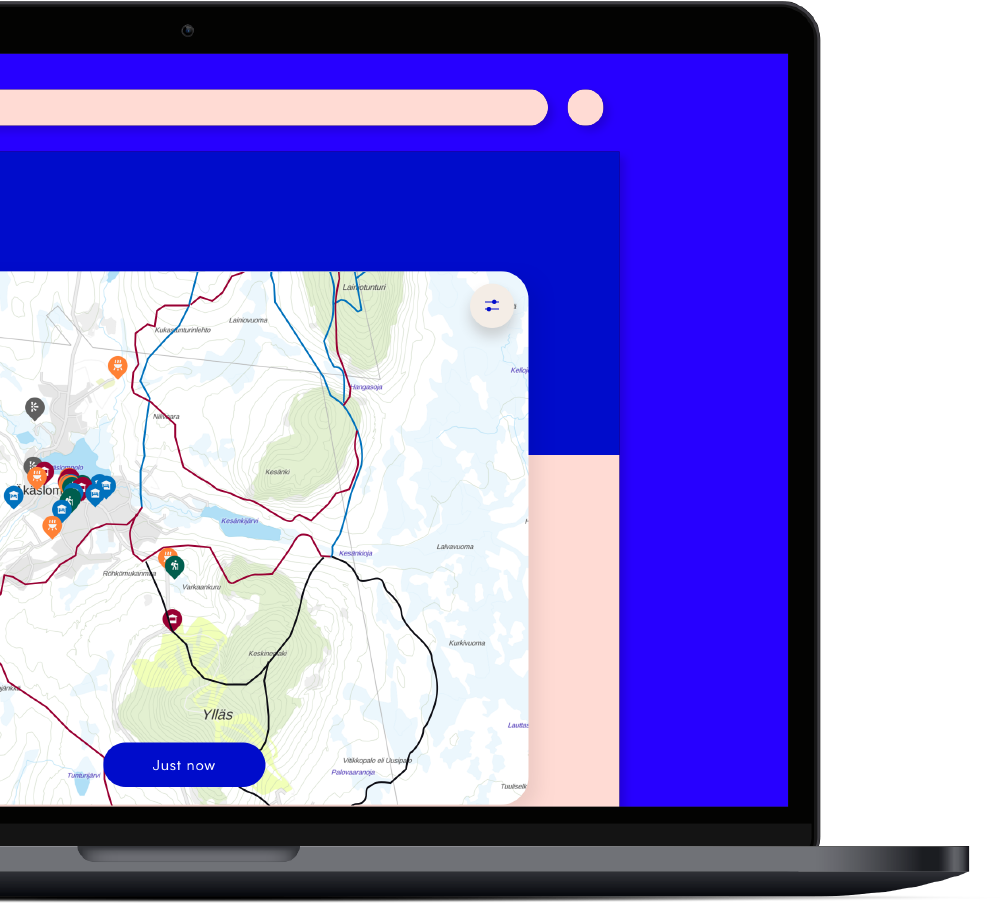 An interactive map with skiing routes shown on a laptop screen